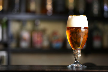 Glass of beer in a bar, close up