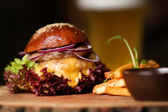 Fresh burger on a wooden board.