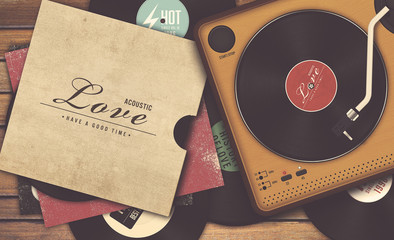 record player and vinyl record on wooden background, vintage tone