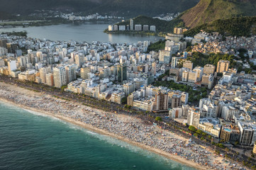 Crowded Beach in Rio de Janeiro at sunset, Brazil