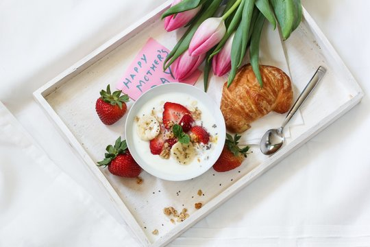 Mother's day breakfast or Brunch / Breakfast yogurt bowl with berries and croissant