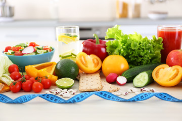 Fresh fruits and vegetables on wooden table closeup