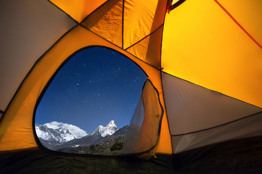 View of the mountains from a tourist tent. From the «window» from left to right there are two eight-thousanders - Mt. Everest (8,848 m), Lhotse (8,516 m) and Ama Dablam (6,814 m).
