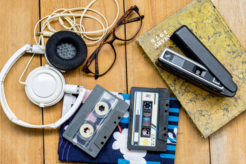 head phone cassette tape glasses diary and old  100 22mm. film c