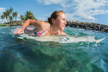Young lady surfer