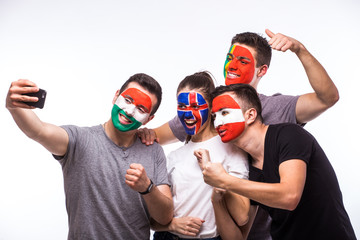 Group of football fans support their national team: Portugal, Hungary, Iceland, Austria take selfie photo on white background. European football fans concept.