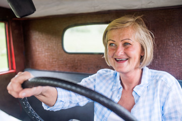 Close up of senior woman inside vintage pickup truck