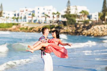 Romantic couple walking on the beach