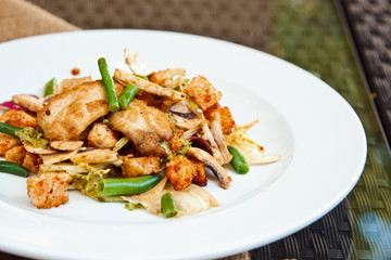 Beautiful mixed salad with chicken fillet, crispy croutons, asparagus and mushrooms in original seasoning
