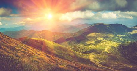 Fotobehang Aubergine Beautiful panoramic mountain landscape at sunset.