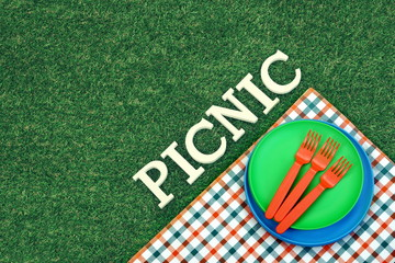 White Sign Picnic On The Lawn And Plates