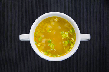 White cup with soup