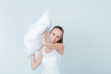 Joyful girl with pillow