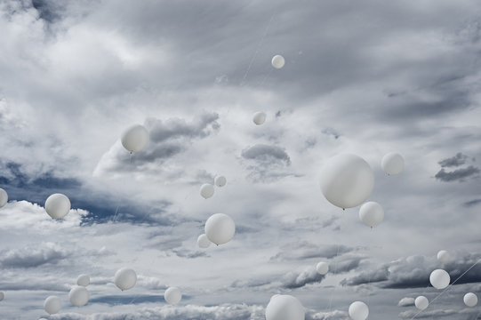 White ballons and clouds