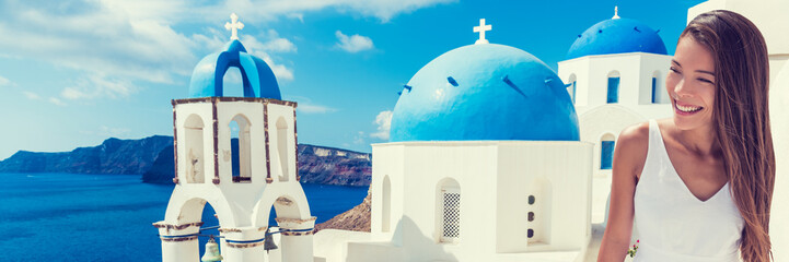 Fototapete - Europe tourist travel woman panorama banner from Oia, Santorini, Greece. Happy young woman looking at famous blue dome church landmark destination. Beautiful girl visiting the Greek islands.