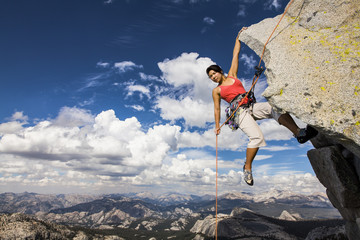 Rock climber clinging to a cliff.