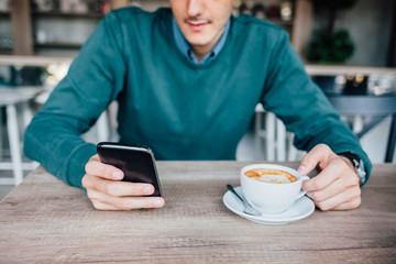 Man using mobile phone and drink coffee