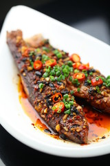 Smoked fire-baked fish