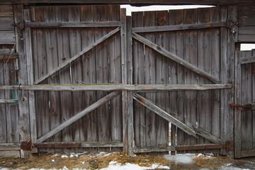 Beautiful old wooden plank door gray color