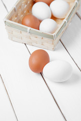 Duck eggs and chicken eggs on wooden table