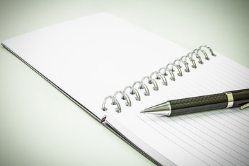 Pen and notepad on white background