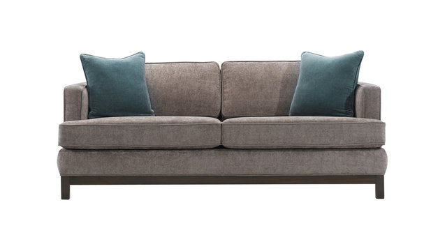 Grey sofa and blue pillows isolated with clipping mask.