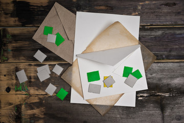 Form letters, stamps and envelope without pattern