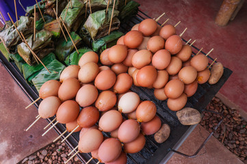 grill eggs at market, Street food at thailand.