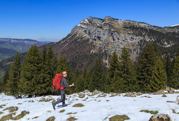 Hiker enjoying the view in the mountains during a springtime  micro adventure.