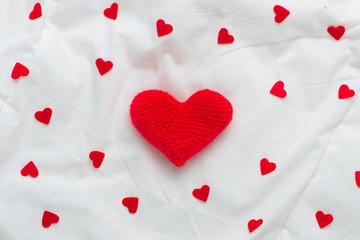 Valentines day hearts on white soft silk background