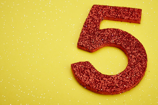 Number five red color over a yellow background. Anniversary