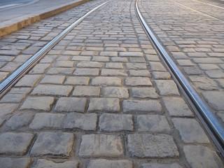 tram line in a cobble stone pavement