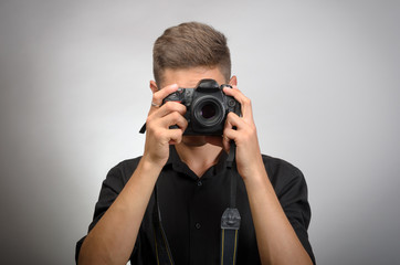 man taking picture with photo camera DSLR