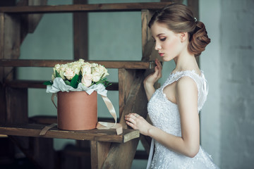 The young beautiful bride with roses in the box