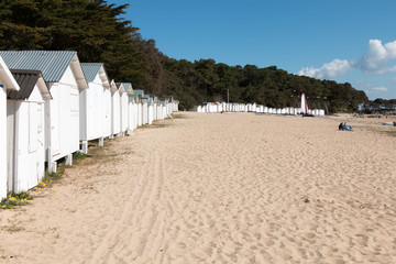 old white beach huts