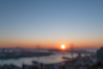 Blurred city view during sunset.