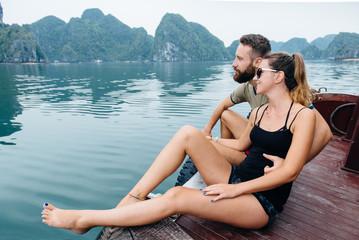 Couple hugging on cruise ship, view on Ha long Bay