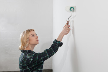 woman working with roller brush