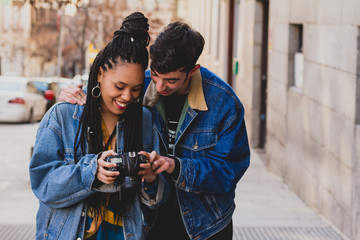 Couple with a camera on the street