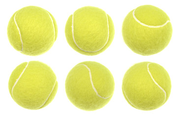 Different tennis balls photographed with studio flash. Isolated on white. Close up shot with plenty of details.