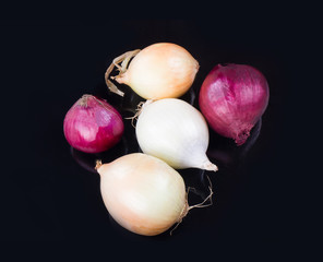 some onions on a black background