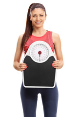 Beautiful woman holding a weight scale