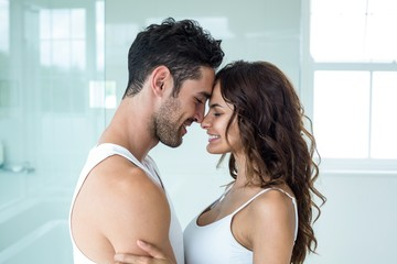 Young romantic couple standing face to face