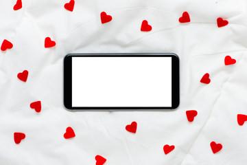 blank screen smartphone on a white soft silk background