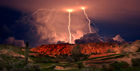 Thunderstorm in Cappadocia. Turkey/Mountain view of Cappadocia during a thunderstorm. The unusual red color of the landscape.