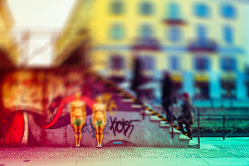 Intentionally blurred colorful filtered view of people walking on a bridge in Milan