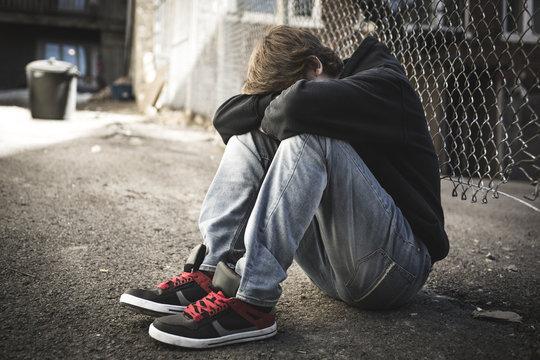 Sorrowful Kid on the City Street