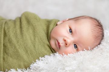 Beautiful newborn wrapped in a blanket