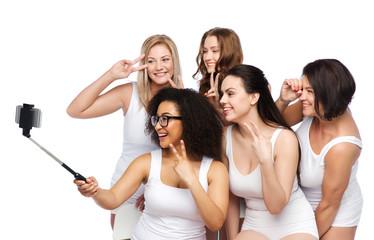 group of happy women taking selfie by smartphoone
