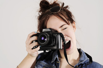 Funny young and trendy hipster girl with photo camera